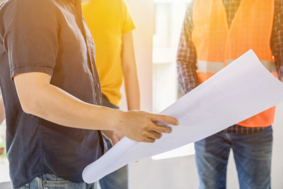Engineer,Team,Discuss,And,Working,At,Construction,Property,Site.,Inspection